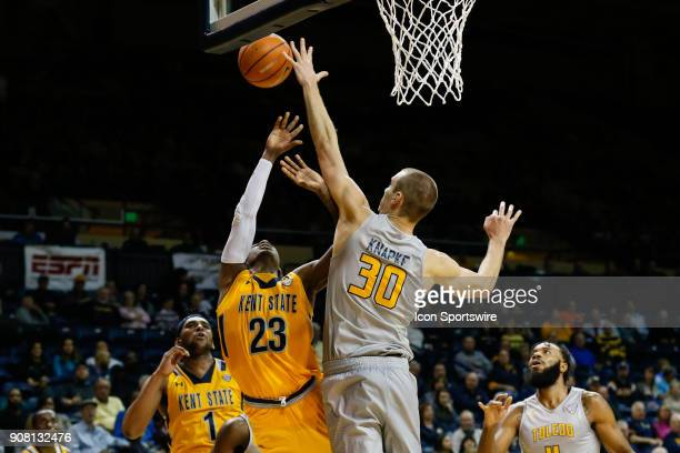 Toledo Rockets forward Luke Knapke blocks a shot by Kent State Golden Flashes guard Jaylin Walker during the second half of a regular season...