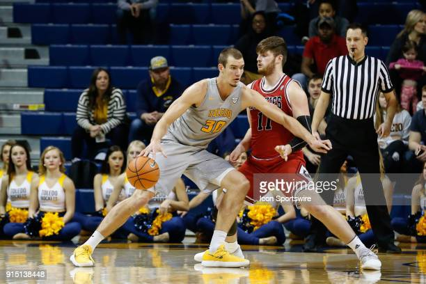 Toledo Rockets forward Luke Knapke drives to the basket against Northern Illinois Huskies forward Noah McCarty during the second half of a regular...