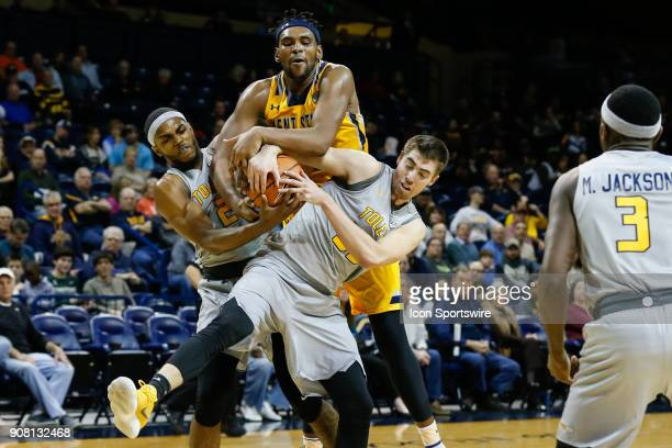 Toledo Rockets forward Nate Navigato and Toledo Rockets forward Taylor Adway battle to grab a rebound against Kent State Golden Flashes center Adonis...