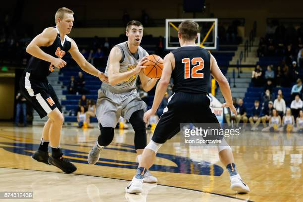 Toledo Rockets forward Nate Navigato looks to pass the ball while being defended by Ohio Northern Polar Bears forward Daniel Donner and Ohio Northern...