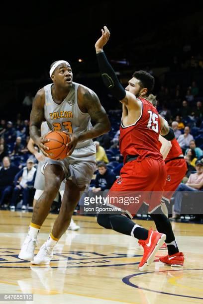 Toledo Rockets forward Steve Taylor Jr drives to the basket against Ball State Cardinals forward Franko House during a regular season basketball game...