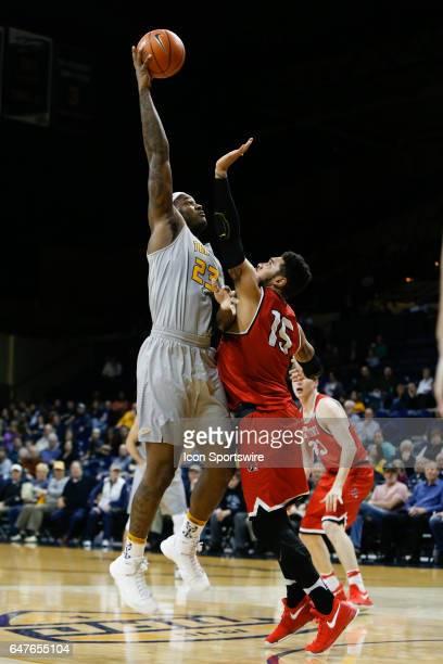 Toledo Rockets forward Steve Taylor Jr shoots over Ball State Cardinals forward Franko House during a regular season basketball game between the Ball...