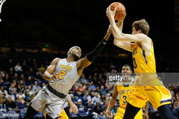Toledo Rockets forward Taylor Adway and Kent State Golden Flashes guard Mitch Peterson battle to grab a rebound during the first half of a regular...