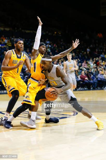 Toledo Rockets forward Taylor Adway drives to the basket against Kent State Golden Flashes guard Jaylin Walker during the first half of a regular...