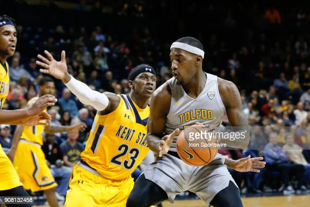 Toledo Rockets forward Taylor Adway looks to drive to the basket against Kent State Golden Flashes guard Jaylin Walker during the first half of a...