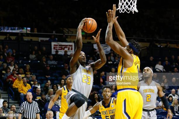 Toledo Rockets forward Willie Jackson drives to the basket against Kent State Golden Flashes center Adonis De La Rosa during the first half of a...
