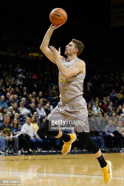 Toledo Rockets guard Dylan Alderson goes in for a layup during the first half of a regular season MidAmerican Conference game between the Kent State...