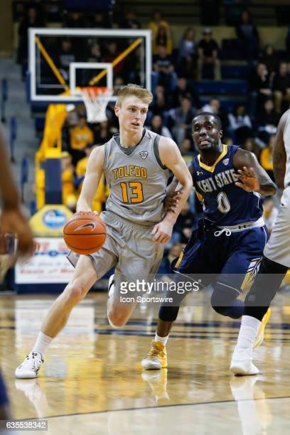 Toledo Rockets guard Jaelan Sanford drives to the basket against Kent State Golden Flashes guard Jalen Avery during a regular season basketball game...