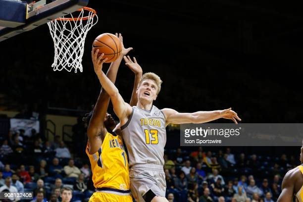Toledo Rockets guard Jaelan Sanford goes in for a layup against Kent State Golden Flashes center Adonis De La Rosa during the first half of a regular...