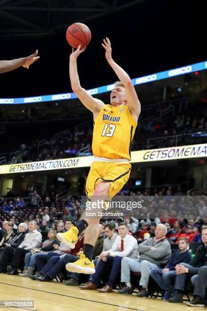 Toledo Rockets guard Jaelan Sanford puts up an offbalance shot during the first half of the MAC Mens Basketball Tournament Championship game between...