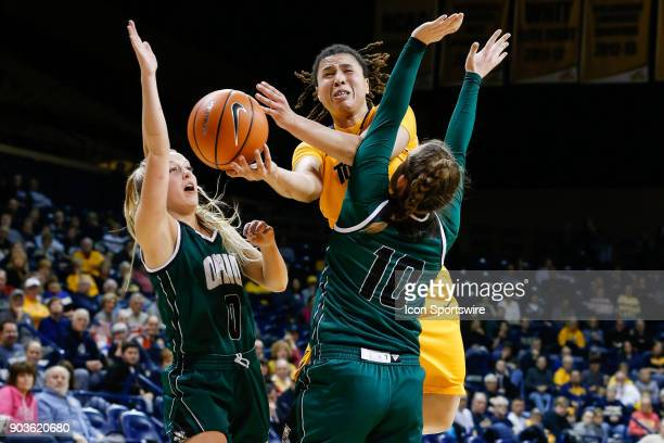 Toledo Rockets guard JayAnn BravoHarriott goes in for a layup between Ohio Bobcats guard Taylor Agler and Ohio Bobcats guard Dominique Doseck during...
