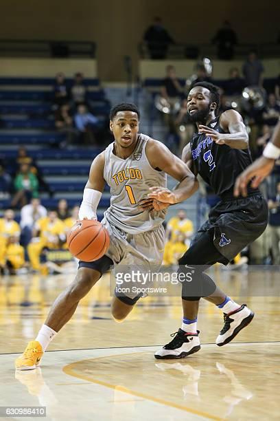 Toledo Rockets guard Jonathan Williams drives to the basket against Buffalo Bulls forward Willie Conner during a regular season basketball game...
