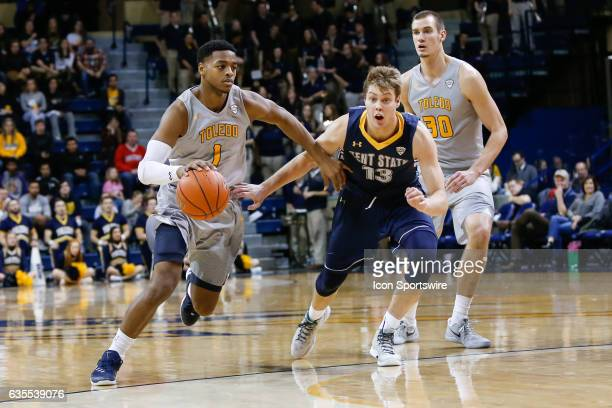 Toledo Rockets guard Jonathan Williams drives to the basket against Kent State Golden Flashes guard Mitch Peterson during a regular season basketball...