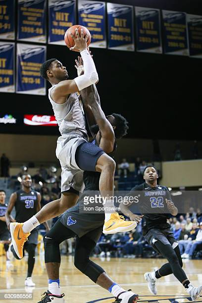 Toledo Rockets guard Jonathan Williams goes in for a layup during a regular season basketball game between the Buffalo Bulls and the Toledo Rockets...