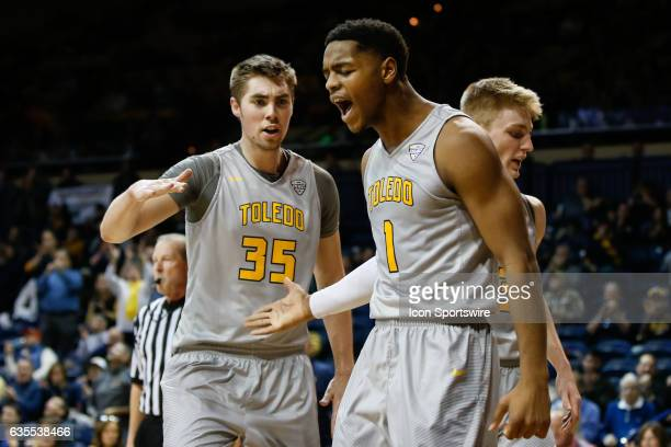 Toledo Rockets guard Jonathan Williams reacts to an offensive play with Toledo Rockets forward Nate Navigato during a regular season basketball game...