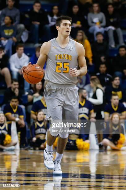 Toledo Rockets guard Jordan Lauf brings the ball upcourt during a regular season basketball game between the Kent State Golden Flashes and the Toledo...