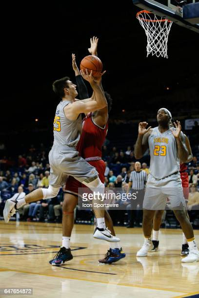 Toledo Rockets guard Jordan Lauf puts up a shot during a regular season basketball game between the Ball State Cardinals and the Toledo Rockets on...