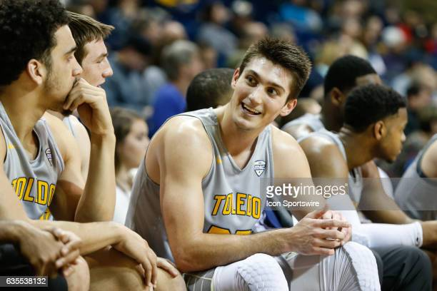 Toledo Rockets guard Jordan Lauf talks with teammates on the bench during a regular season basketball game between the Kent State Golden Flashes and...