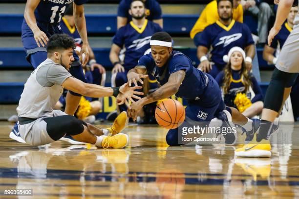 Toledo Rockets guard Justin Roberts and Jackson State Tigers guard Charles Taylor Jr scramble for a loose ball during a regular season nonconference...