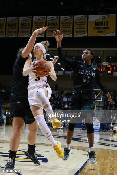 Toledo Rockets guard Mariella Santucci goes in for a layup against Eastern Michigan Hurons center Autumn Hudson , left and Eastern Michigan Hurons...