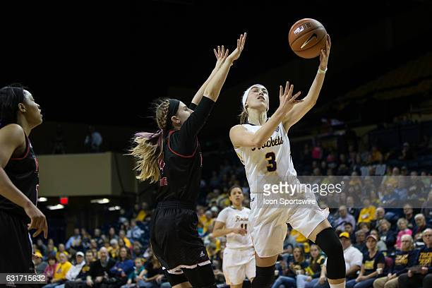 Toledo Rockets guard Mariella Santucci goes in for a layup against Northern Illinois Huskies guard Courtney Woods during a regular season basketball...