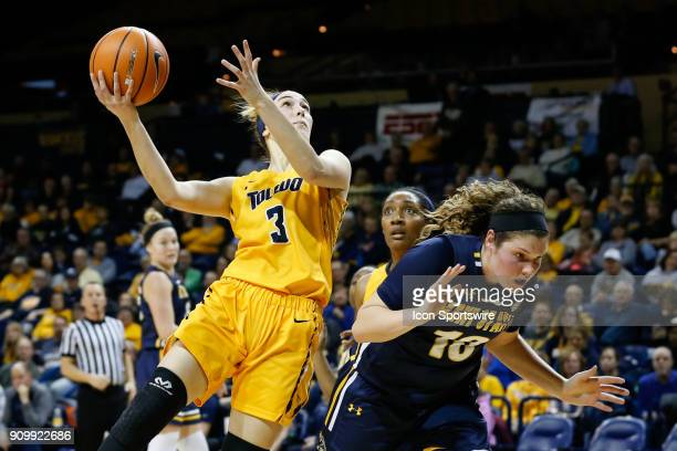 Toledo Rockets guard Mariella Santucci goes in for a layup against Kent State Golden Flashes forward McKenna Stephens during the second half of a...