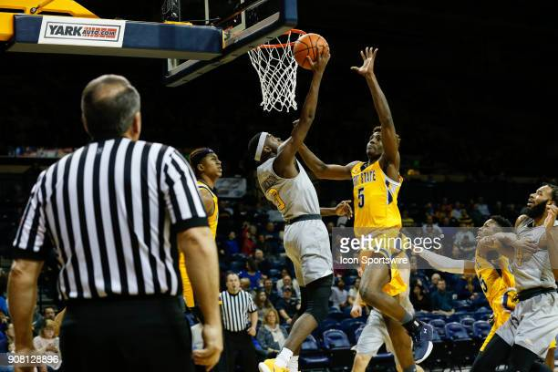 Toledo Rockets guard Marreon Jackson goes in for a layup against Kent State Golden Flashes forward Danny Pippen during the first half of a regular...