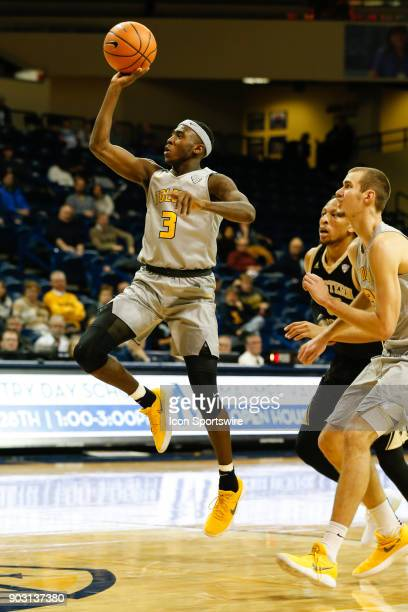 Toledo Rockets guard Marreon Jackson goes in for a layup during the second half of a regular season MidAmerican Conference game between the Western...