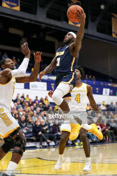 Toledo Rockets guard Marreon Jackson goes up for a shot as Kent State Golden Flashes forward Danny Pippen defends during the first half of the men's...