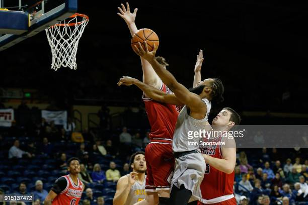 Toledo Rockets guard Tre'Shaun Fletcher goes in for a layup against Northern Illinois Huskies forward Noah McCarty and Northern Illinois Huskies...