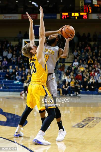 Toledo Rockets guard Tre'Shaun Fletcher looks to pass the ball while being defended by Kent State Golden Flashes guard Mitch Peterson during the...