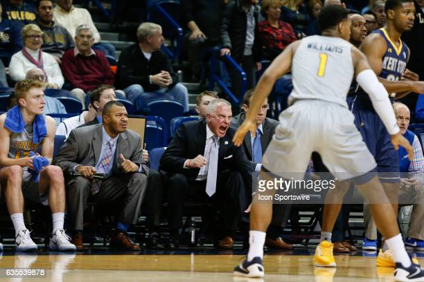 Toledo Rockets head coach Tod Kowalczyk reacts to his team's performance on the court during a regular season basketball game between the Kent State...