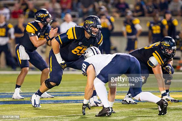 Toledo Rockets offensive lineman Chase Nelson waits for the ball to be snapped during game action between the New Hampshire Wildcats, of the Colonial...
