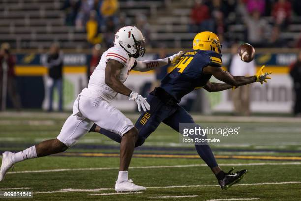 Toledo Rockets wide receiver Darryl Richards catches a pass against Northern Illinois Huskies corner back Albert Smalls during game action between...