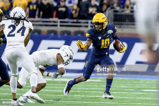 Toledo Rockets WR Desmond Phillips stiffarms Akron Zips CB Alvin Davis in the second quarter of the MAC Championship game between Akron Zips and...