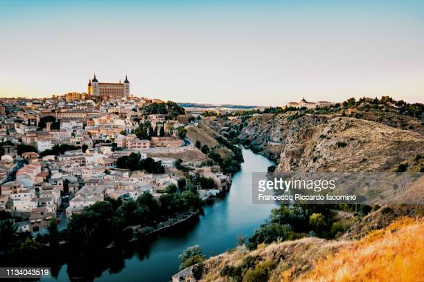 toledo, scenic view of the city at sunset - toledo spain stock pictures, royalty-free photos & images
