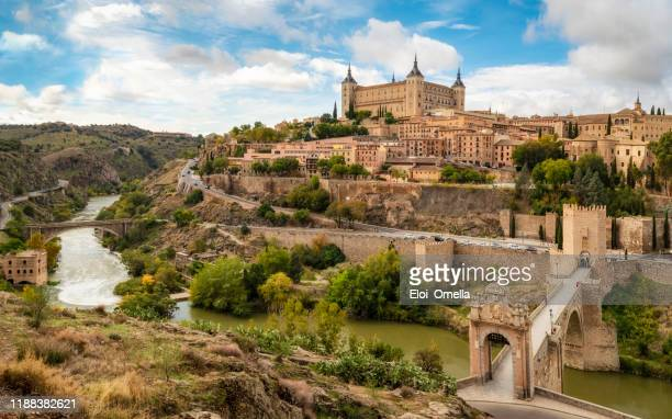 toledo view from alcantara bridge, spain - madrid stock pictures, royalty-free photos & images