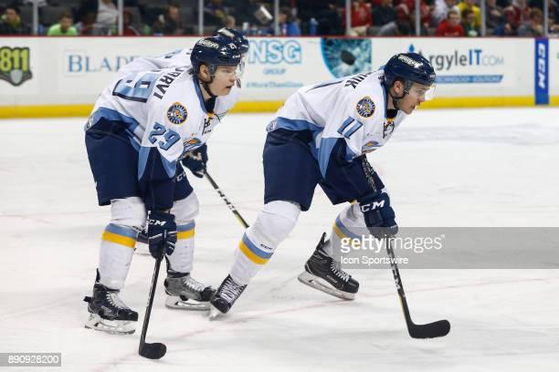 Toledo Walleye forward Vili Saarijarvi of Finland and Toledo Walleye forward Zach Nastasiuk lineup for a faceoff during a regular season ECHL hockey...