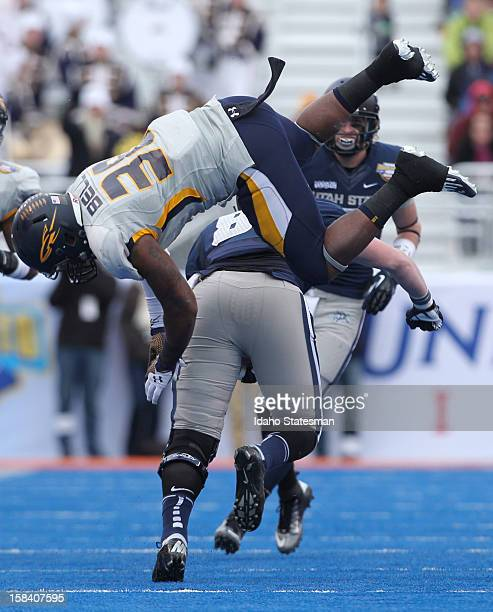 Toledo's Robert Bell is upended as he tries to tackle Utah State's Kellen Bartlett in the first half of the Famous Idaho Potato Bowl at Bronco...