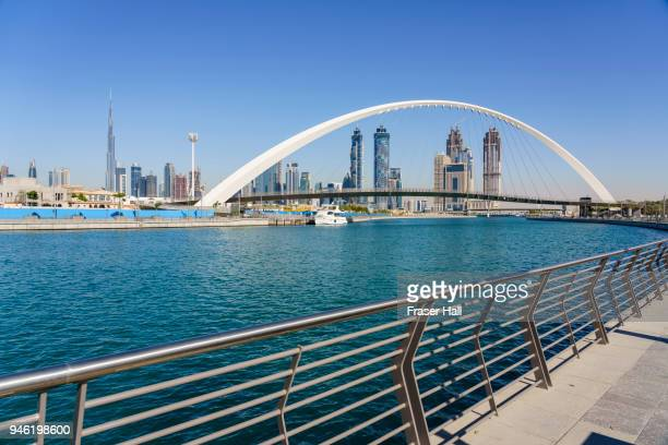tolerance bridge, dubai water canal - canal stock pictures, royalty-free photos & images