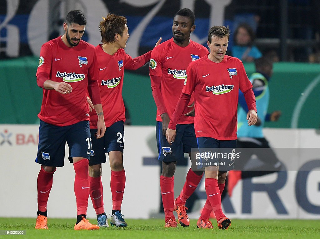 Tolga Cigerci, Genki Haraguchi, Salomon Kalou and Vladimir Darida of Hertha BSC celebrate after scoring the 1:2 during the game between FSV Frankfurt and Hertha BSC on october 27, 2015 in Frankfurt on Main, Germany.