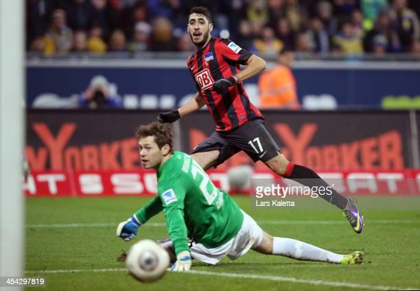 Tolga Cigerci of Berlin scores his team's second goal during the Bundesliga match between Eintracht Braunschweig and Hertha BSC Berlin at Eintracht...