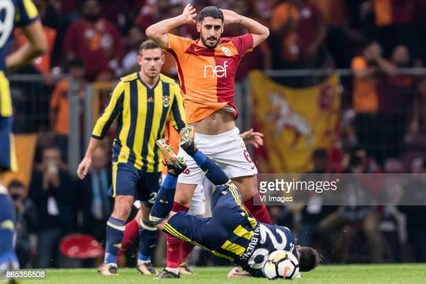 Tolga Cigerci of Galatasaray SK Mathieu Valbuena of Fenerbahce SK during the Turkish Spor Toto Super Lig football match between Galatasaray SK and...