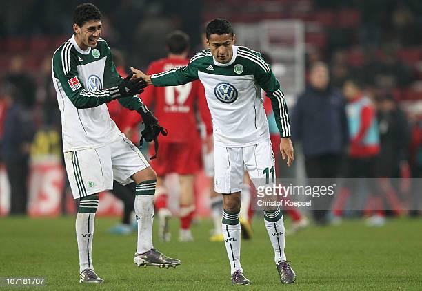 Tolga Cigerci of Wolfsburg shake hands with scorer Cicero after the Bundesliga match between 1 FC Koeln and VfL Wolfsburg at RheinEnergieStadion on...