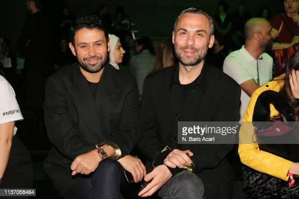 Tolga Sezgin and Ozgur Masur attend the MercedesBenz Fashion Week Istanbul March 2019 at Zorlu Center on March 20 2019 in Istanbul Turkey