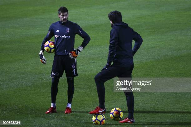 Tolga Zengin and Fabri of Besiktas attend a training session ahead of the second half of the Turkish Super Lig in Antalya Turkey on January 8 2018
