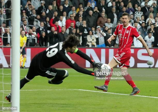 Tolga Zengin of Besiktas saves from Robert Lewandowski of Bayern Muenchen during the UEFA Champions League Round of 16 Second Leg match Besiktas and...