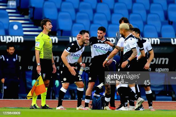 Tolgay Ali Arslan of Udinese Calcio celebrates with his teammates after scoring the opening goal during the Serie A match between SS Lazio and...
