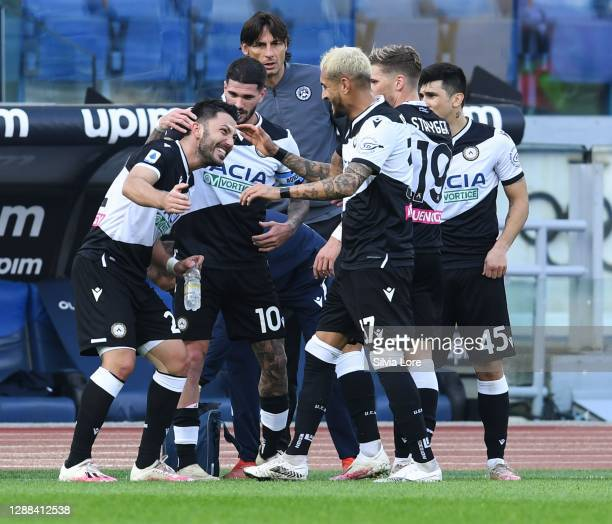 Tolgay Ali Arslan of Udinese Calcio celebrates with his teammates after scoring goal 0-1 during the Serie A match between SS Lazio and Udinese Calcio...