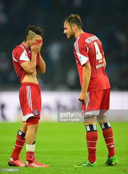 Tolgay Arslan and Heiko Westermann of Hamburg look dejected at the end of the Bundesliga match between Hertha BSC and Hamburger SV at Olympiastadion...